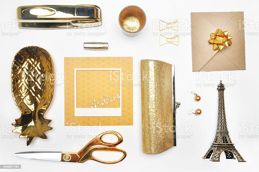 Gold items. Flat lay. Accessories on the table, woman desk top. View top table, background mock up. Envelope top - fotografia de stock