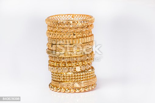 gold bangles and necklace isolated on white background