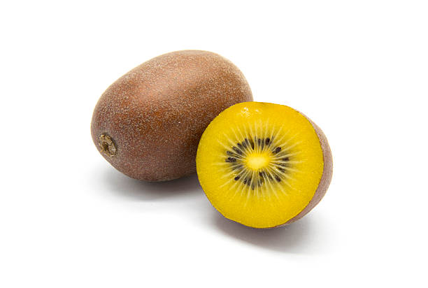 gold kiwifruits on white background - 奇異果 個照片及圖片檔