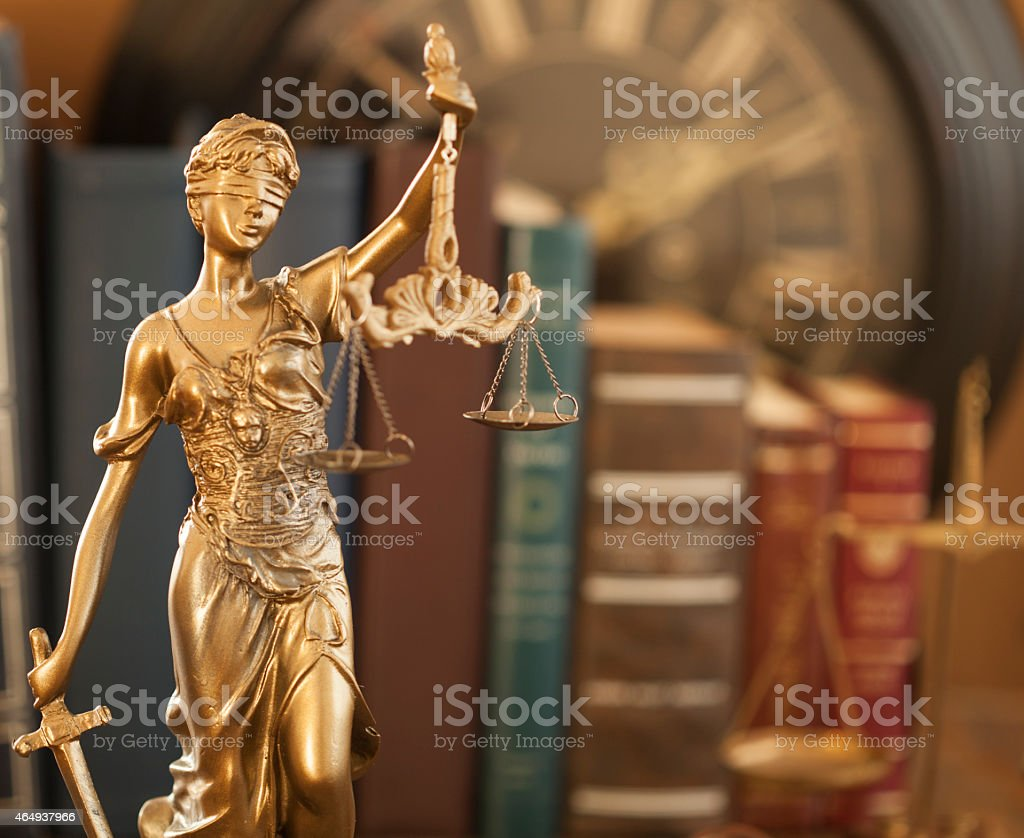 Gold lady law statue in a library setting stock photo