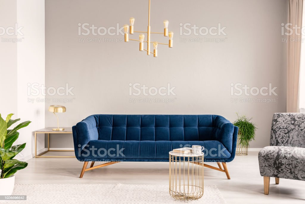 Outstanding Gold Lamp Hanging Above Royal Blue Sofa In Real Photo Of Evergreenethics Interior Chair Design Evergreenethicsorg