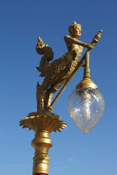 Gold lamps and lighting pole background with a blue sky