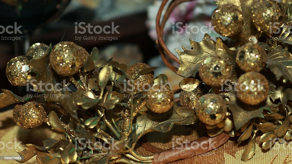 Gold Leaf Balls of Holly with Glitter stock photo