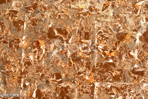186835568istockphoto 24K Gold Leaf Flakes Background 184117675