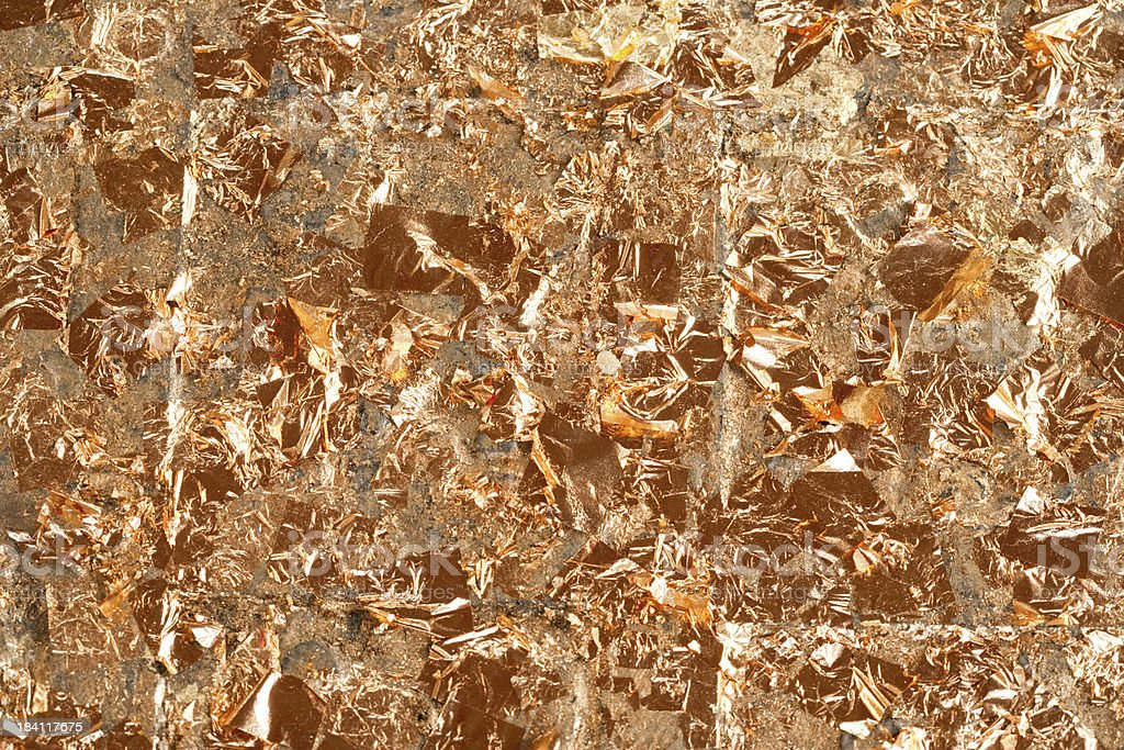 24K Gold Leaf Flakes Background stock photo