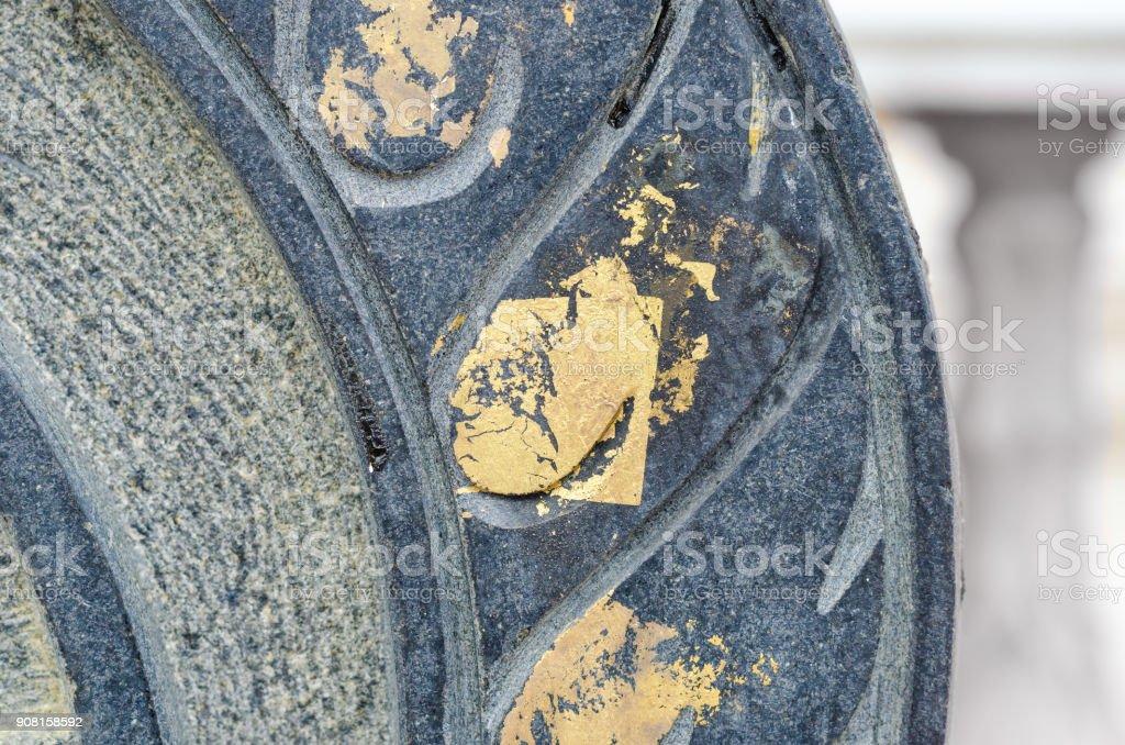 gold leaf onto stone, Thailand stock photo