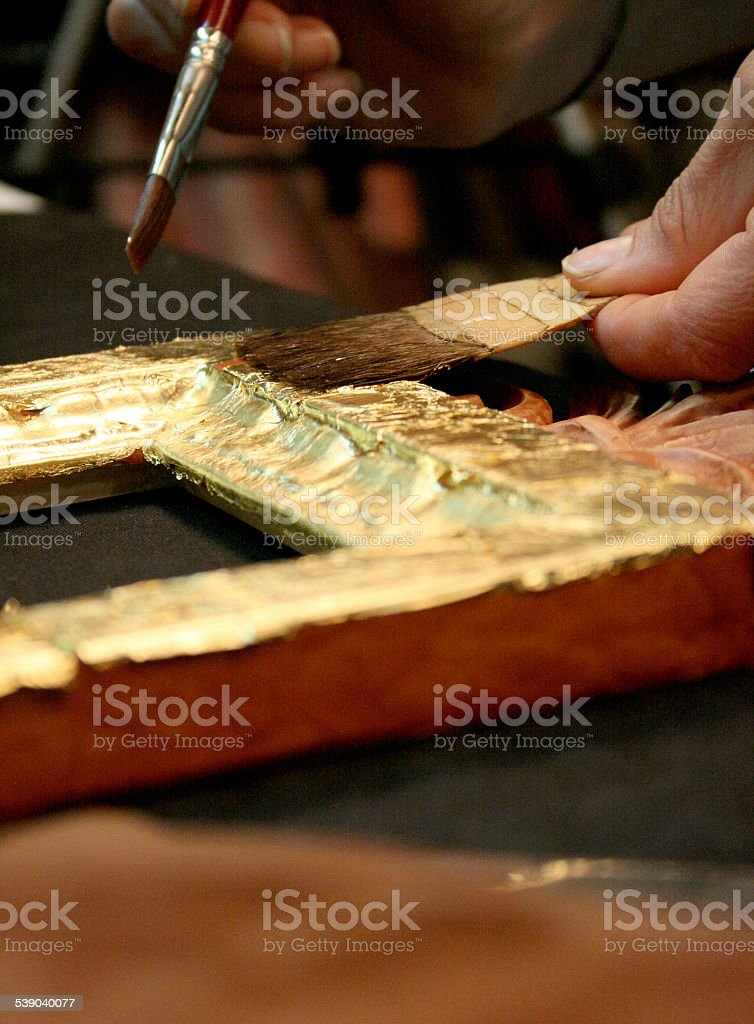 Gold leaf processing stock photo