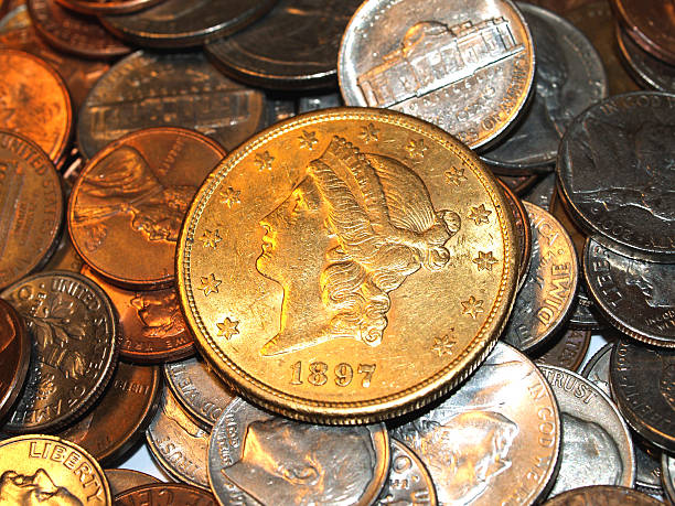 Gold Liberty Dollar 1897 with modern American Coins stock photo