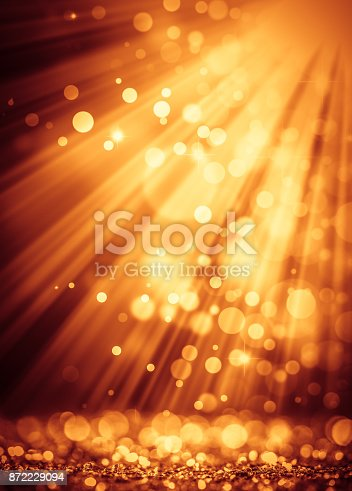 872398892 istock photo Gold light beam on defocused sparkles 872229094