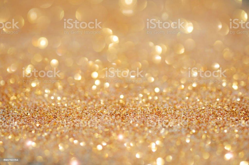 Gold light bokeh texture or glitter lights festive gold background....