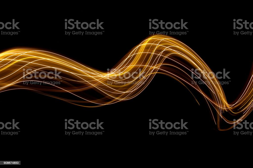 Long exposure photograph of metallic gold fairy lights, in a range of...