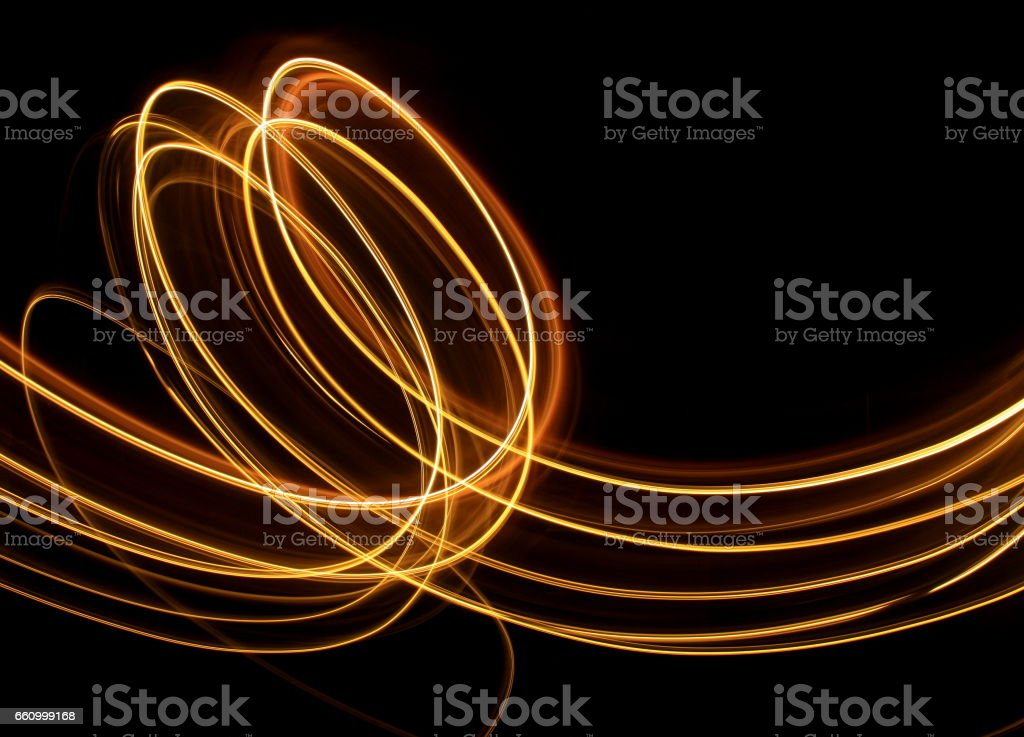 Gold Light Painting Photography, swirls and loops on a clean black background stock photo