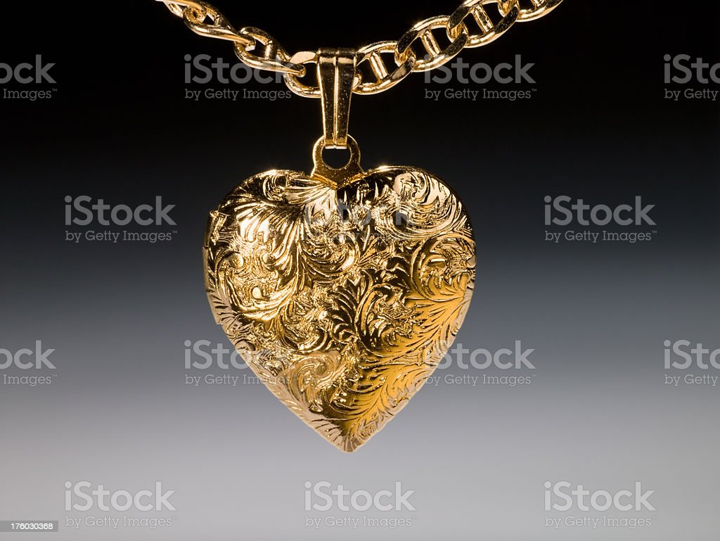 Gold locket necklace royalty-free stock photo