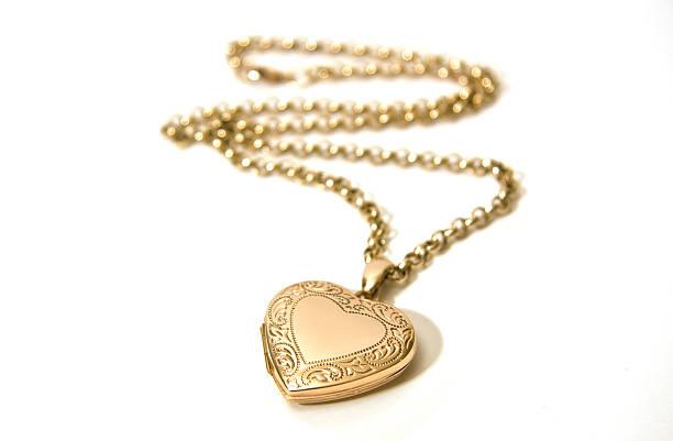 gold открывающийся медальон - ожерелье стоковые фото и изображения