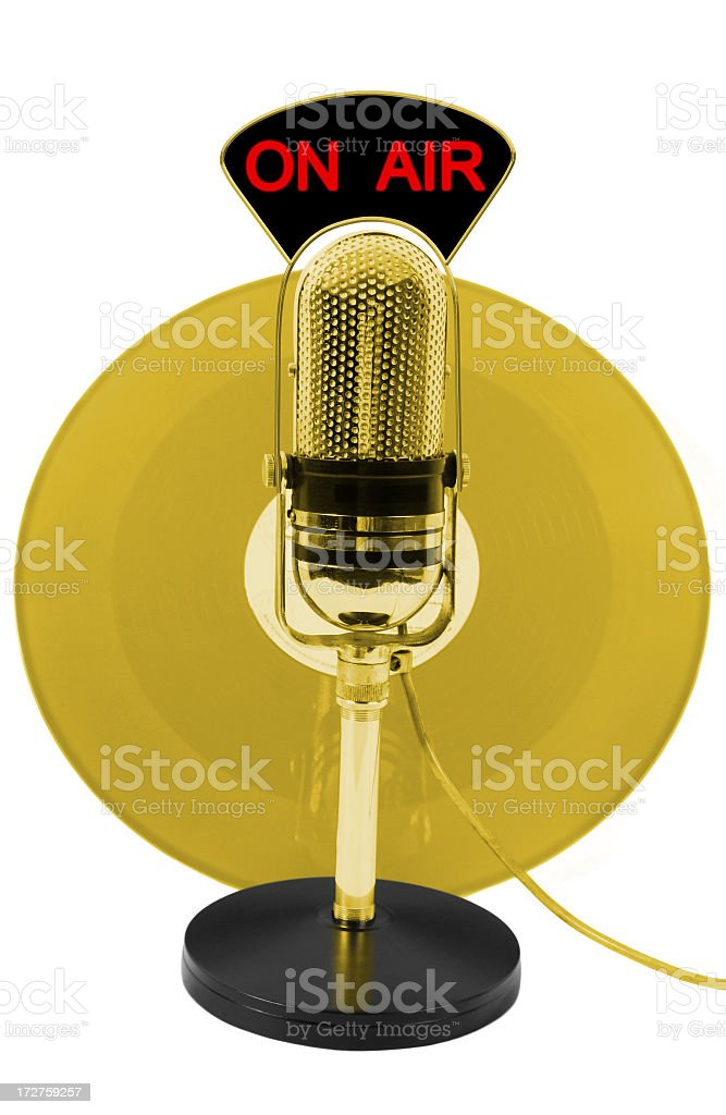 Gold LP and microphone stock photo