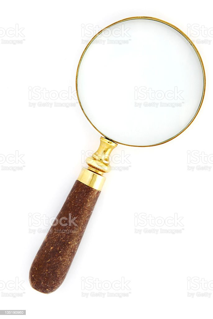 Gold magnifying glass with a wooden handle stock photo