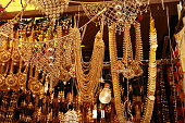 Gold jewellery hanging in a gold shop, jewelers market