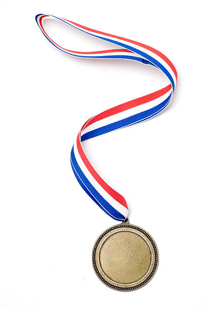Gold medal award with red, white and blue ribbon A gold medal on a multi-colored ribbon. medal stock pictures, royalty-free photos & images