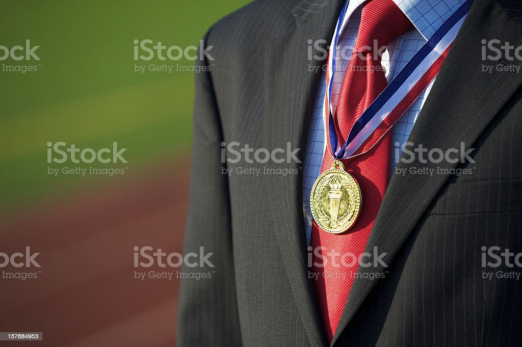 Gold Medal Businessman Sports Track Background stock photo