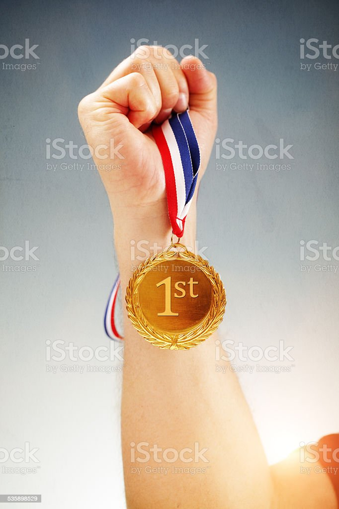 Gold medal first place winner stock photo