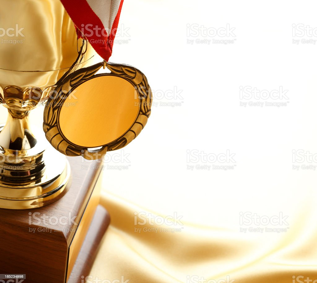 Gold medal hanging from a trophy stock photo