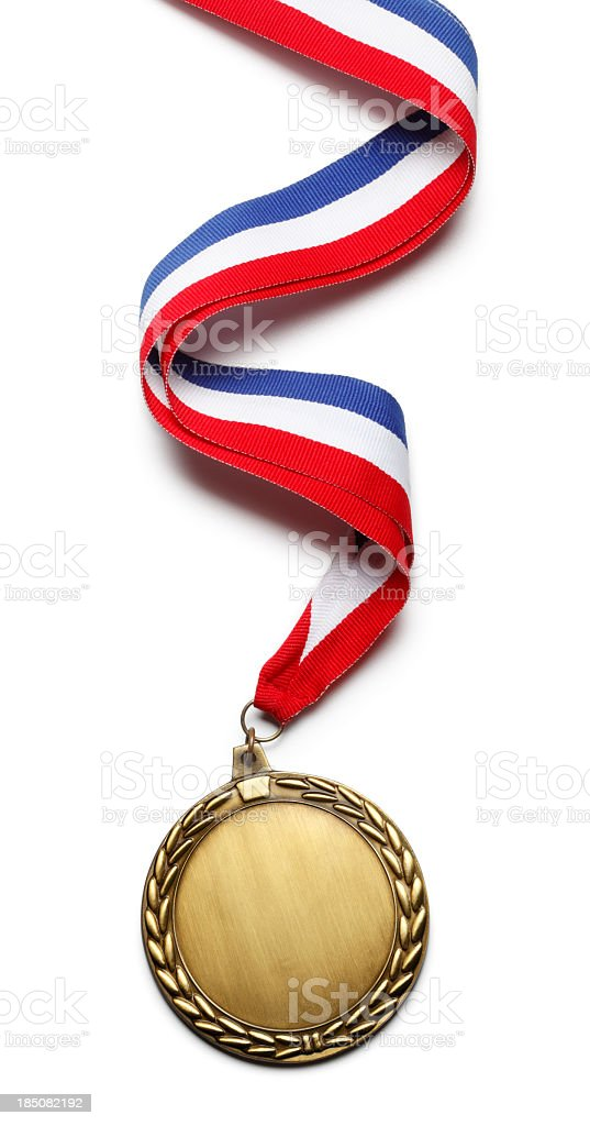 Gold medal hanging from red white and blue ribbon stock photo