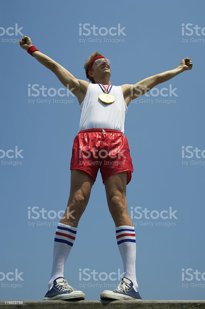 Gold Medal Nerd Athlete Stands with Arms Raised royalty-free stock photo