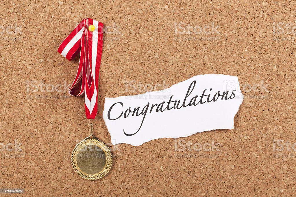 Gold Medal on Corkboard with Congratulations Message royalty-free stock photo