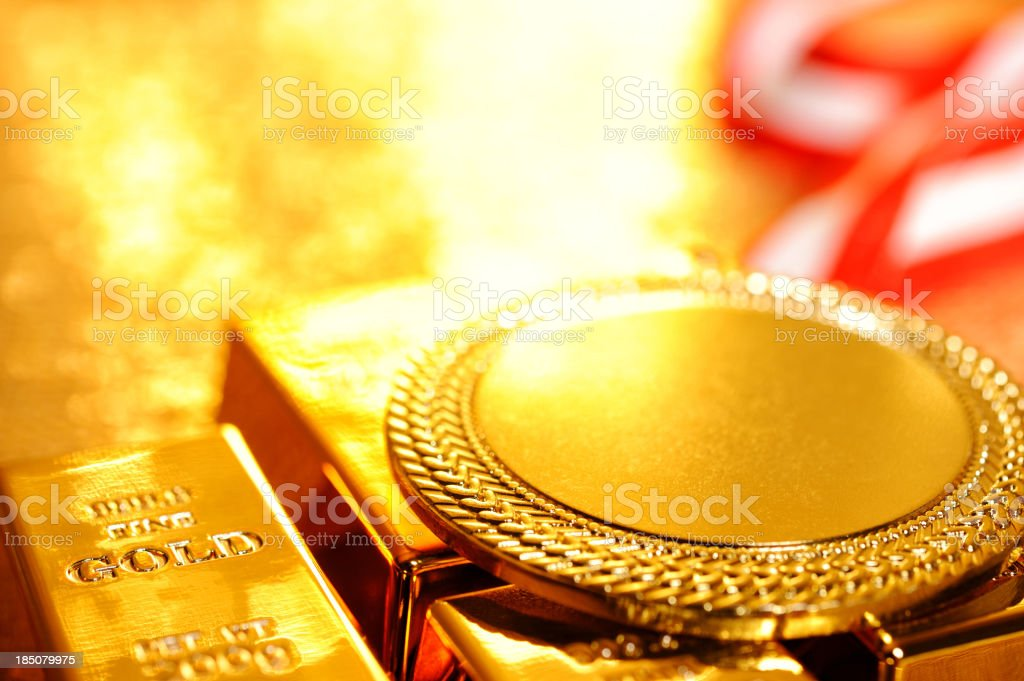 Gold medal on ingots royalty-free stock photo