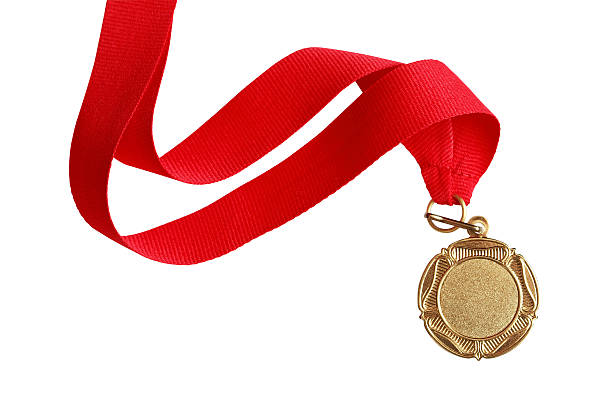 Gold Medal Gold medal with nice long red ribbon on white background. Isolated with clipping path medal stock pictures, royalty-free photos & images