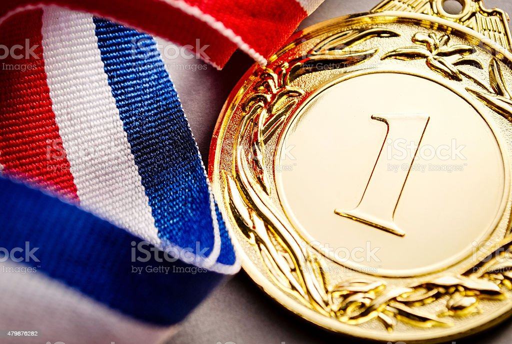 Gold medal winner at the light background stock photo