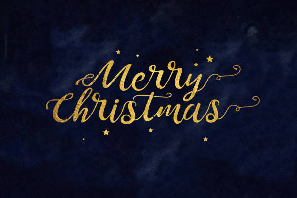 Gold Merry Christmas Text with Stars stock photo