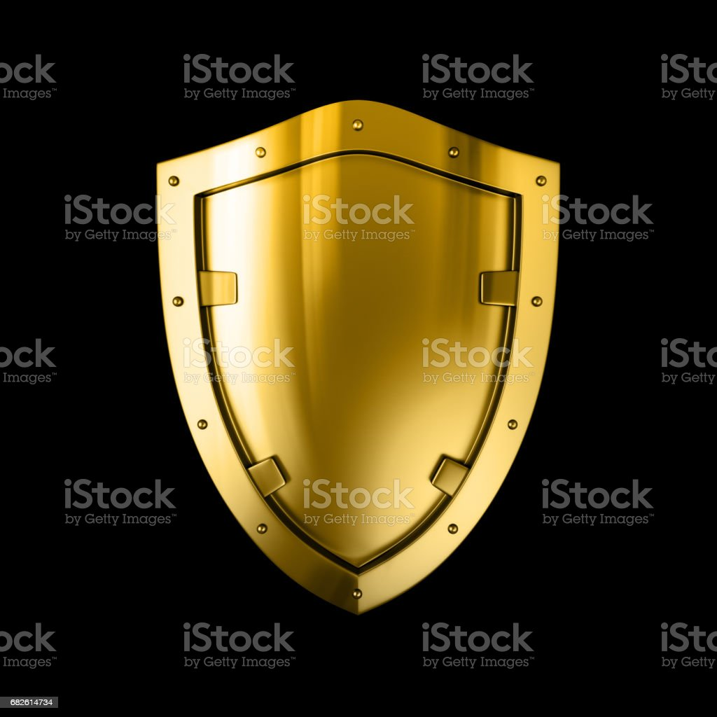 Gold metal shield, isolated against the Black background stock photo