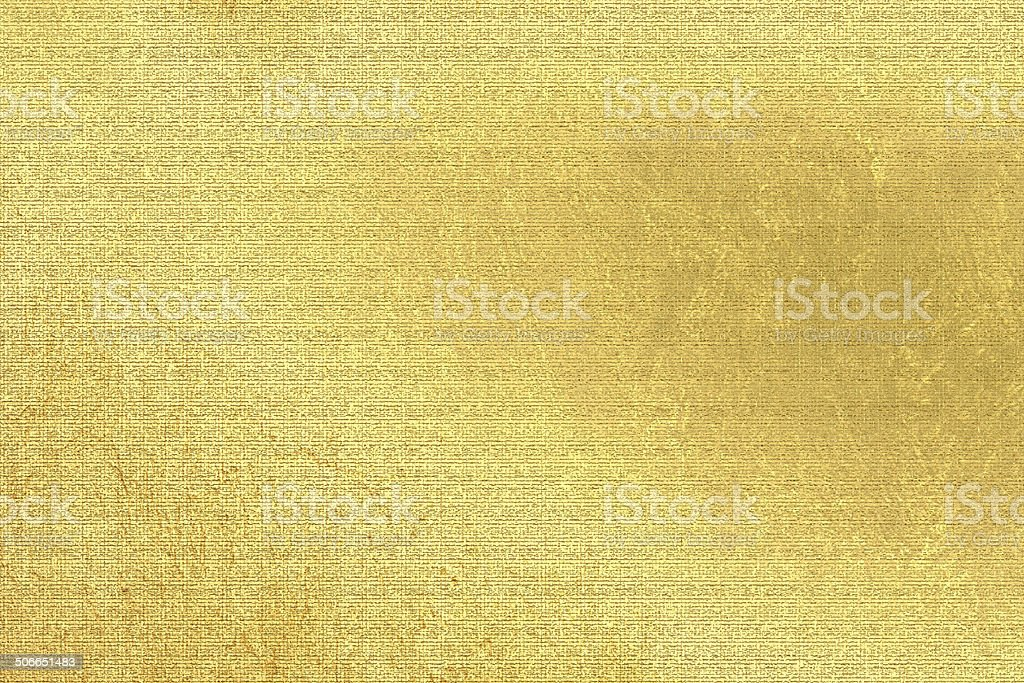 Gold metallic background, linen texture, bright festive and business backdrop stock photo