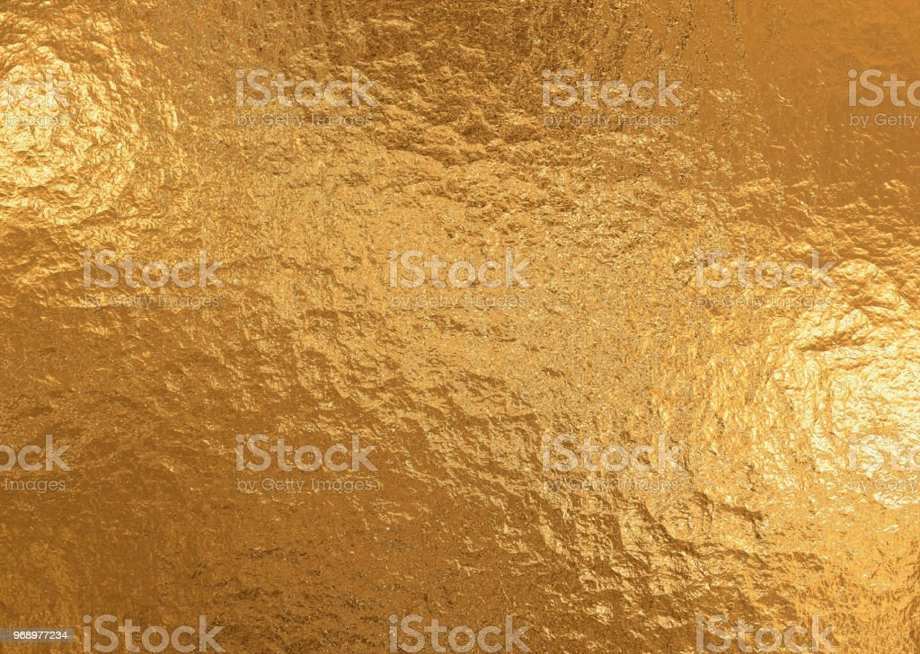 Gold metallic background, linen texture, bright festive background stock photo