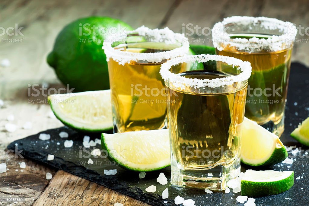 Gold Mexican tequila with lime and salt stock photo