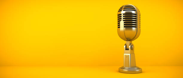 gold microphone on yellow background stock photo
