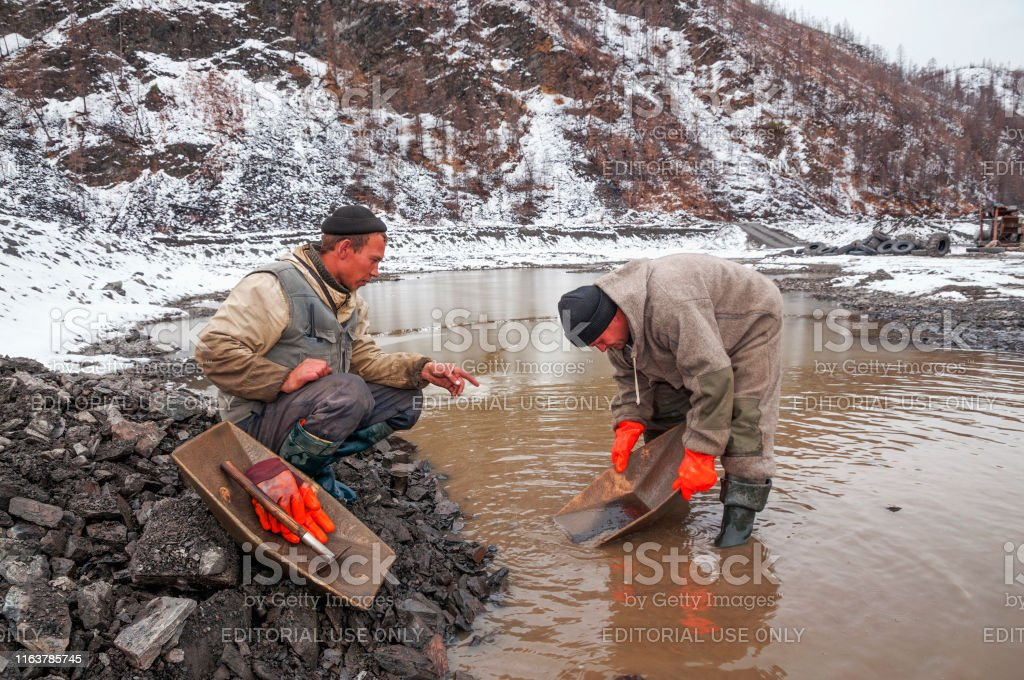Ust-Nera, Yakutia, Russia - September 25, 2009: Gold miner with his...