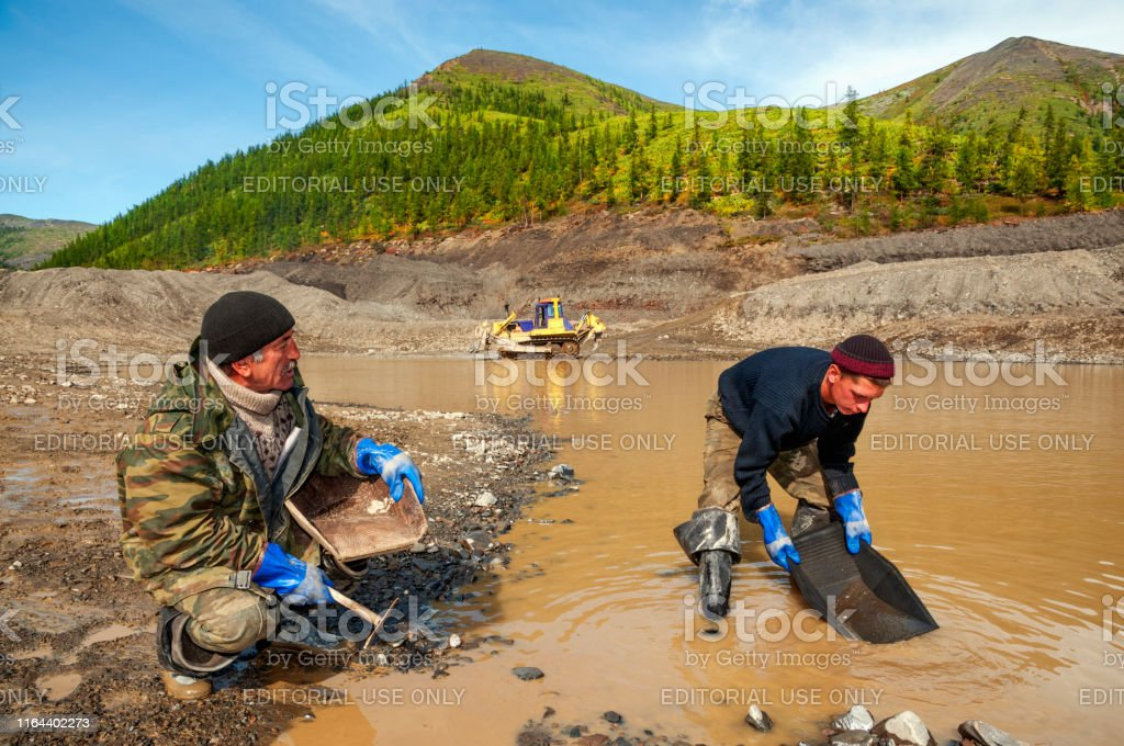 Ust-Nera, Yakutia, Russia - August 24, 2010: Gold miner with his...