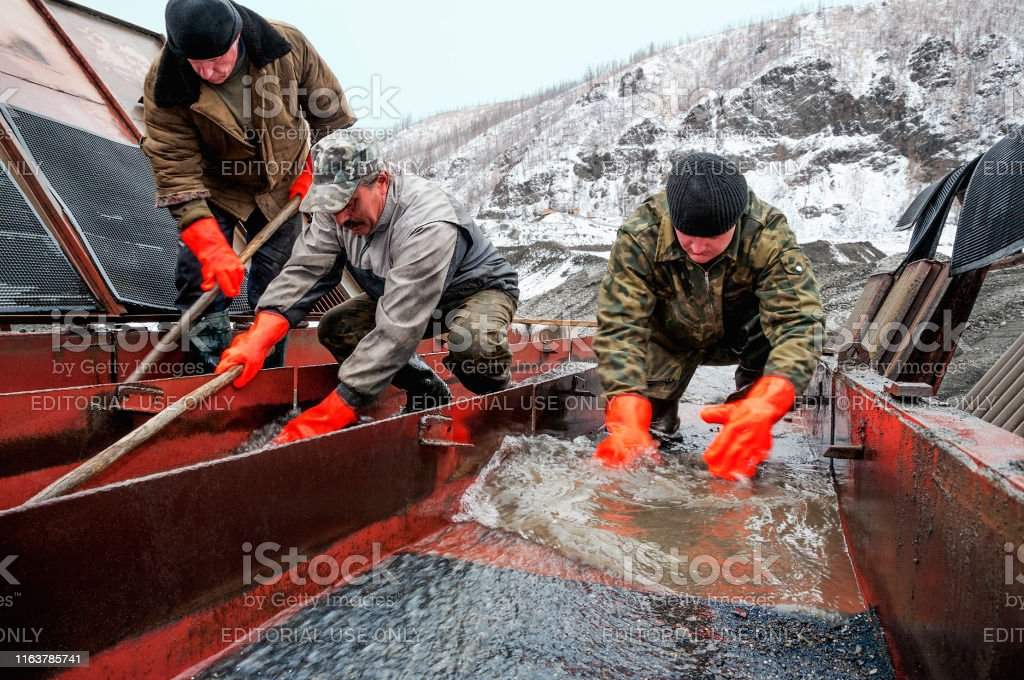 Ust-Nera, Yakutia, Russia - September 23, 2009: Gold miners , removed...