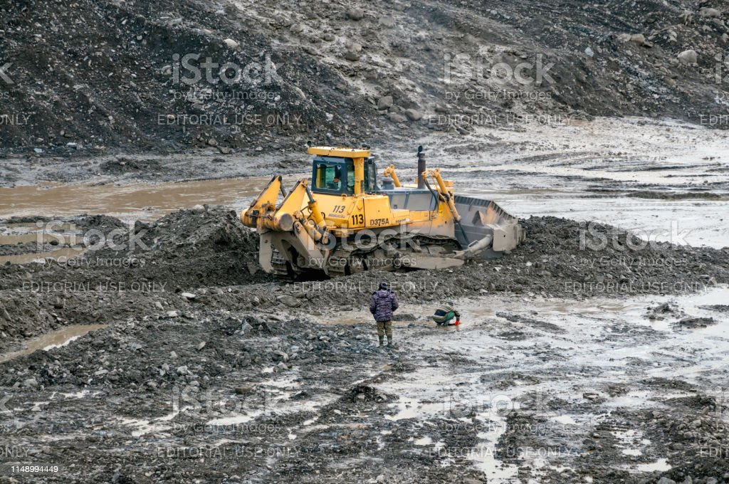 Gold mining in Yakutia Gold lies here at a depth of 5-6 meters....