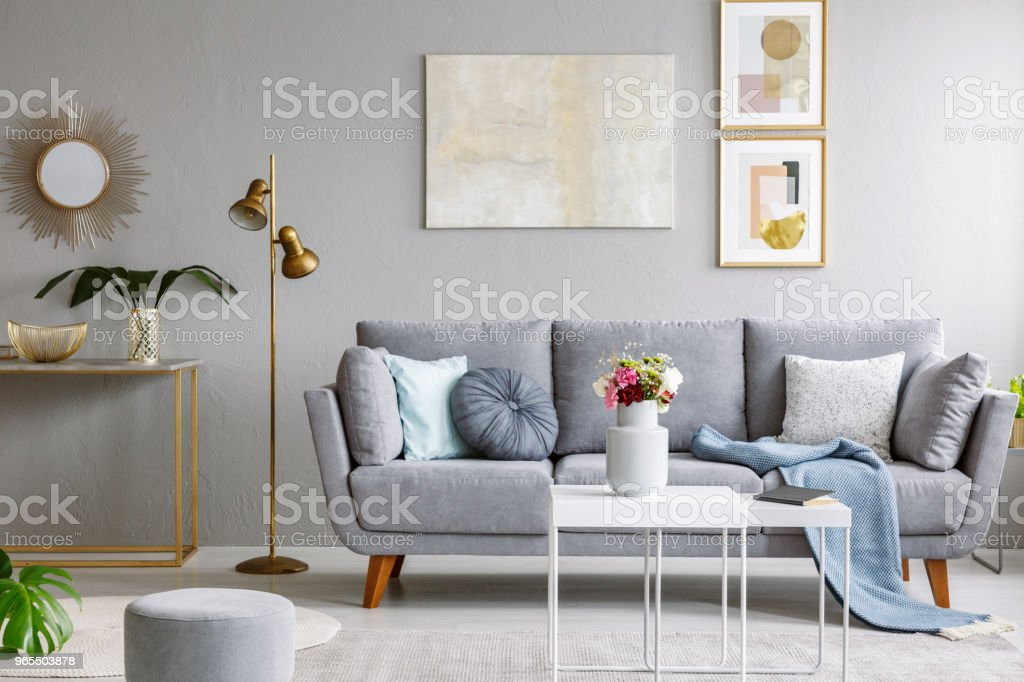 Gold Mirror Above Shelf With Plant In Grey Living Room ...