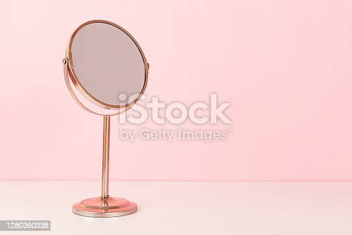 istock Gold mirroron pink background. Vanity table concept. 1280360338