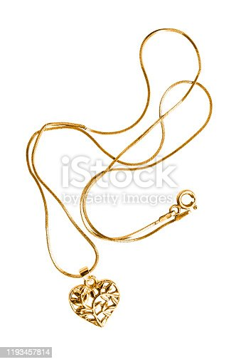 Gold necklace with heart shaped pendant on white background