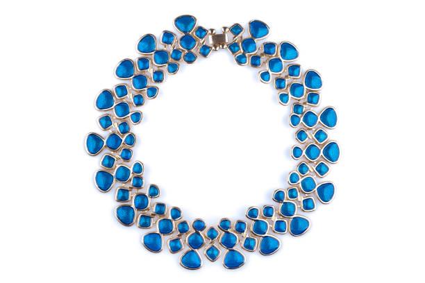 gold necklace with blue rhinestones - ожерелье стоковые фото и изображения