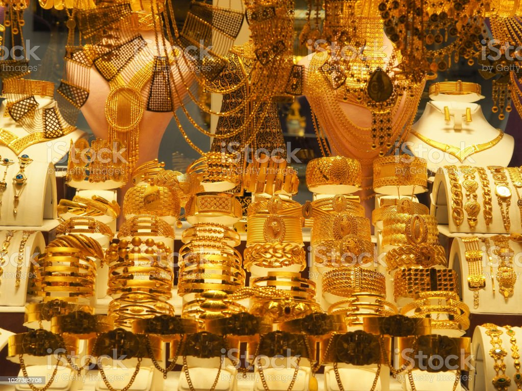 Gold Necklaces Bracelets And Various Jewelery Sold In A Jewelery