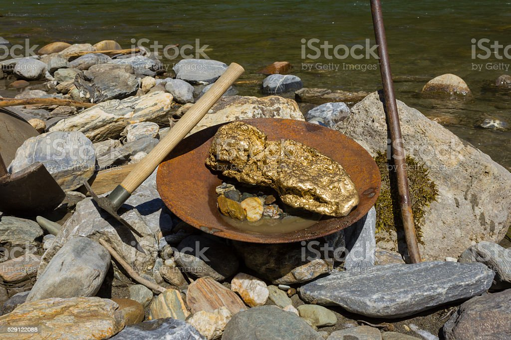 Gold Nugget mining from the River, with a gold pan, and find some big...