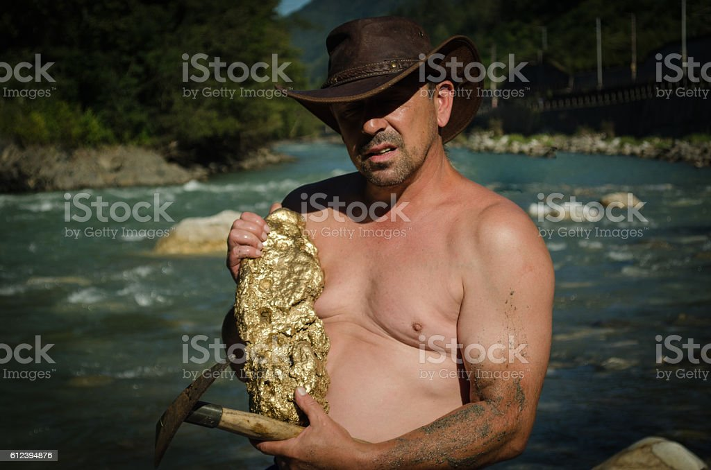 Gold Nugget mining from the River stock photo