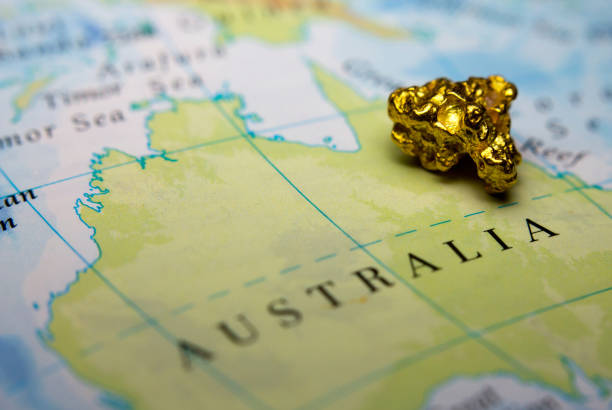 Gold nugget on top of map of Australia stock photo