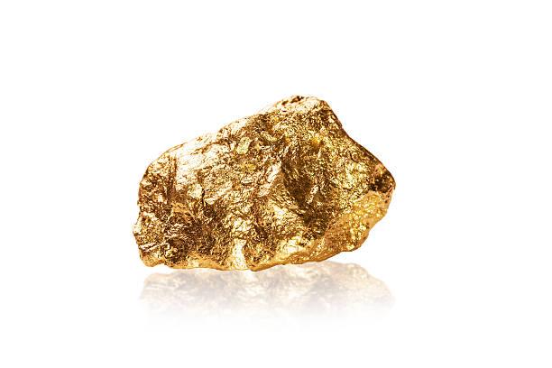 Pépite d'or sur fond blanc. - Photo